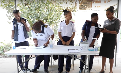 image of nurses signing up patients for COVID-19 testing